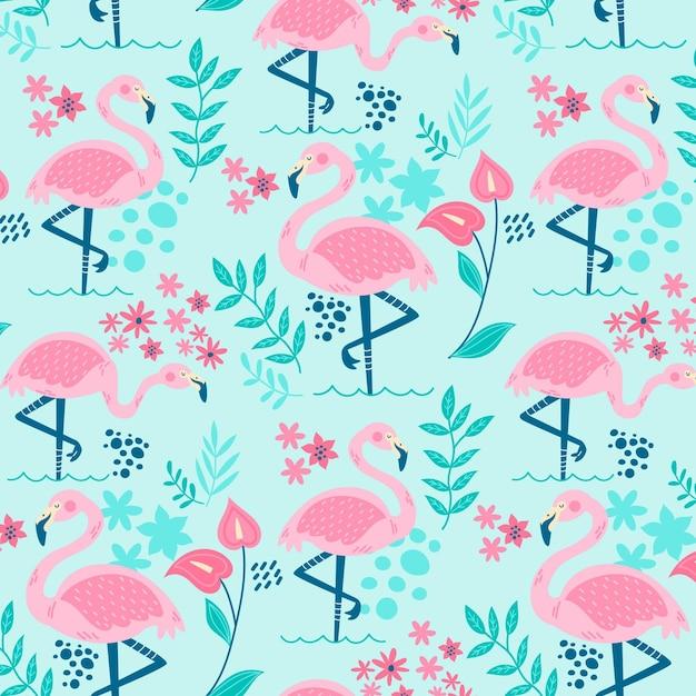 Flamingo's patroon met prachtige tropische bladeren Gratis Vector