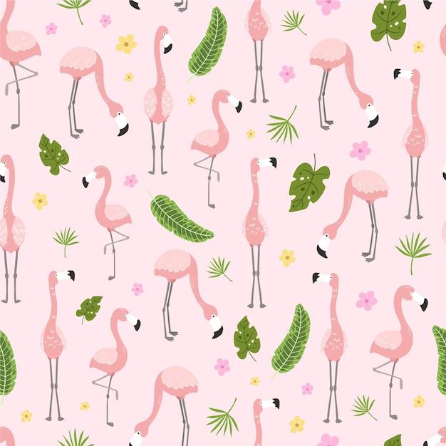 Flamingopatroon met verschillende tropische bladeren Gratis Vector