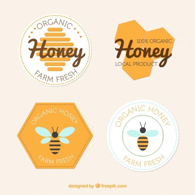 Flat badges van honing Gratis Vector