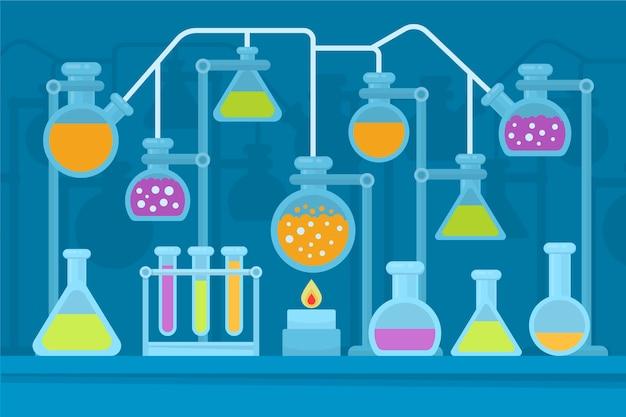 Flat science lab chemie glaswerk en vlammen Gratis Vector