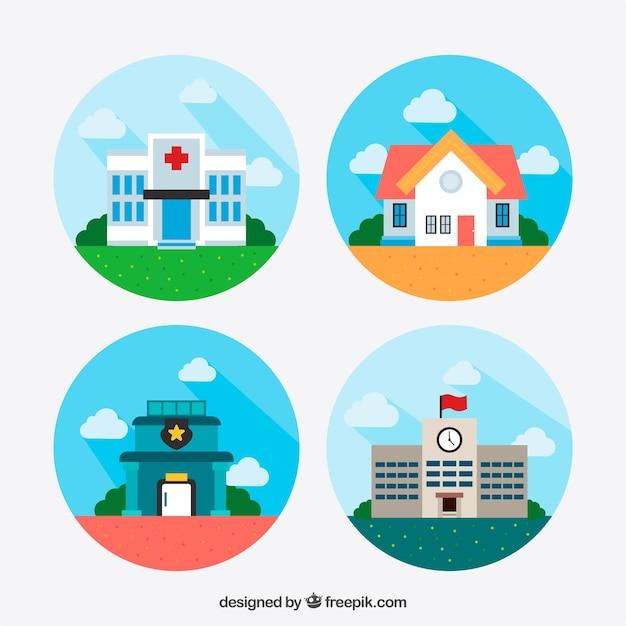 Flat set van gekleurde gebouwen Gratis Vector