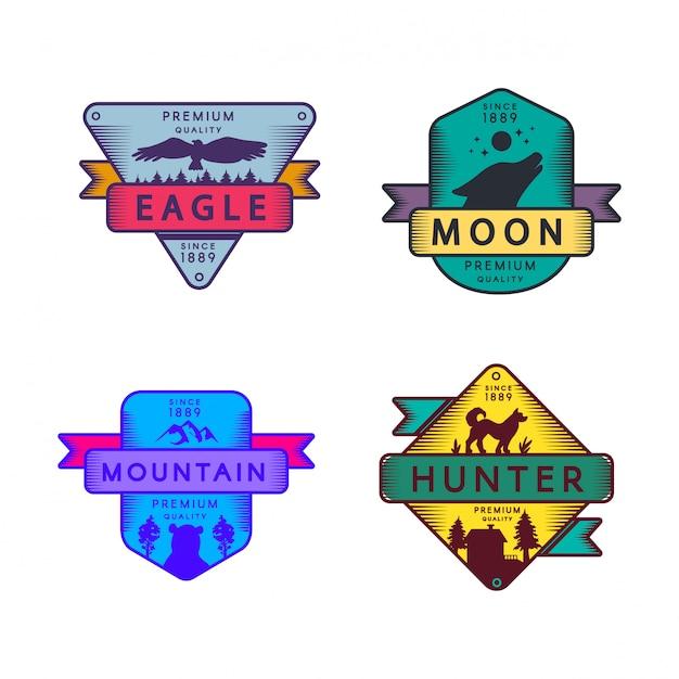 Fly eagle en hunter, moon en mountain set logo. kleurrijk assortiment handelsmerk premiumkwaliteit. huilende wolf en beer Premium Vector