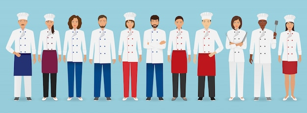 Food service bezetting team staande in uniform. groep catering tekens chef-kok, kok, obers en barman. Premium Vector