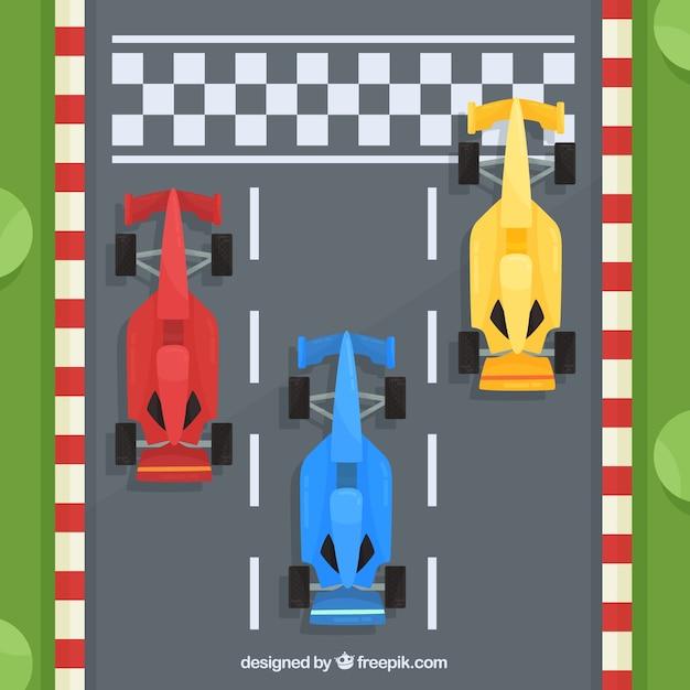 Formule 1-raceauto's bij de finishlijn met bovenaanzicht Gratis Vector