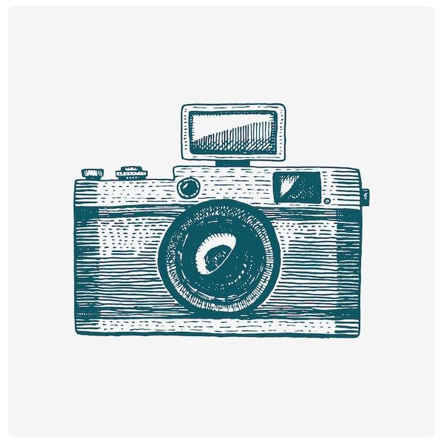 Fotocamera vintage, gegraveerde hand getrokken in schets of houtsnede stijl, oud uitziende retro lens, realistische afbeelding Premium Vector