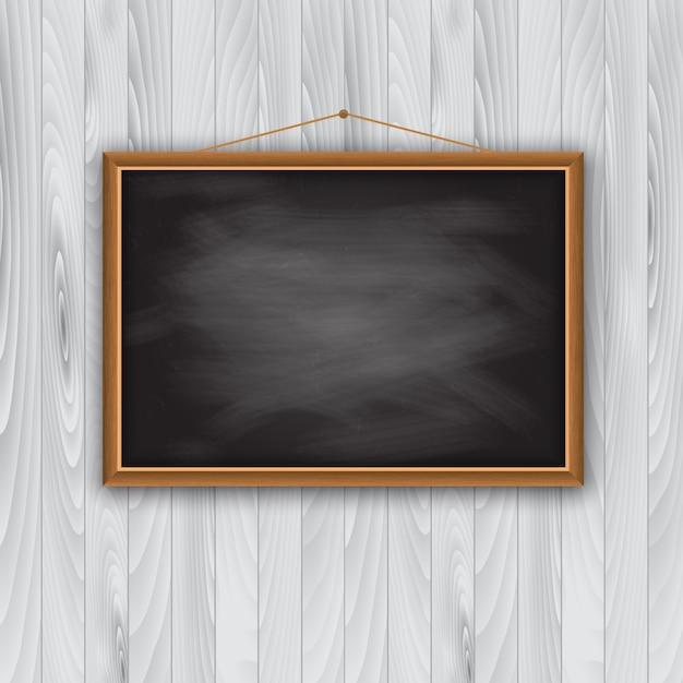 Fotolijst op houten muur Gratis Vector