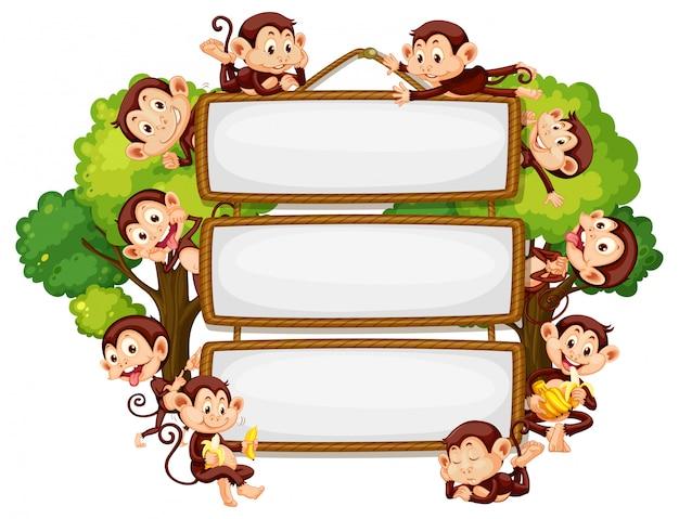 Frame-ontwerp met veel apen rond de rand Gratis Vector