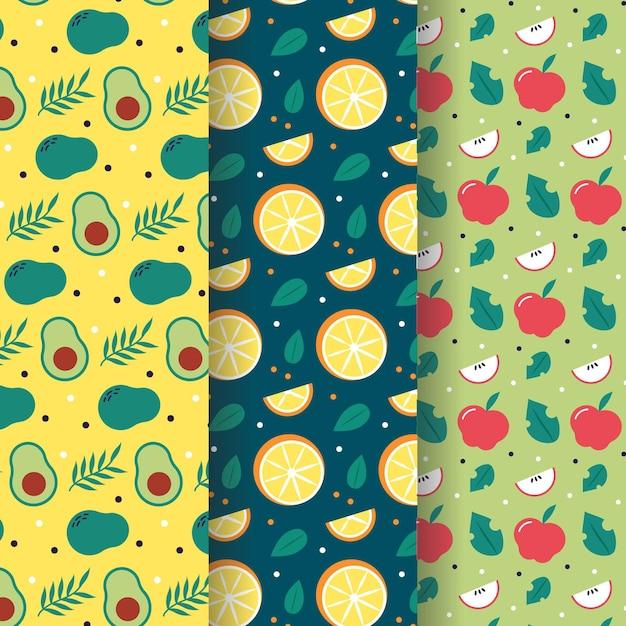 Fruit patroon met avocado, sinaasappels en appels collectie Gratis Vector