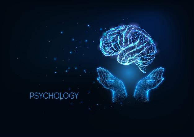 Futuristische psychologieillustratation met gloeiende veelhoekige handen die hersenen houden Premium Vector