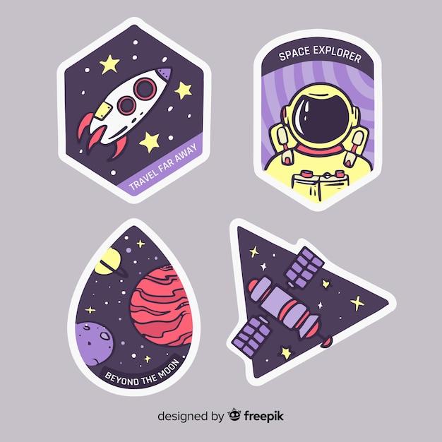 Galaxy-ontwerp met stickerscollectie Gratis Vector