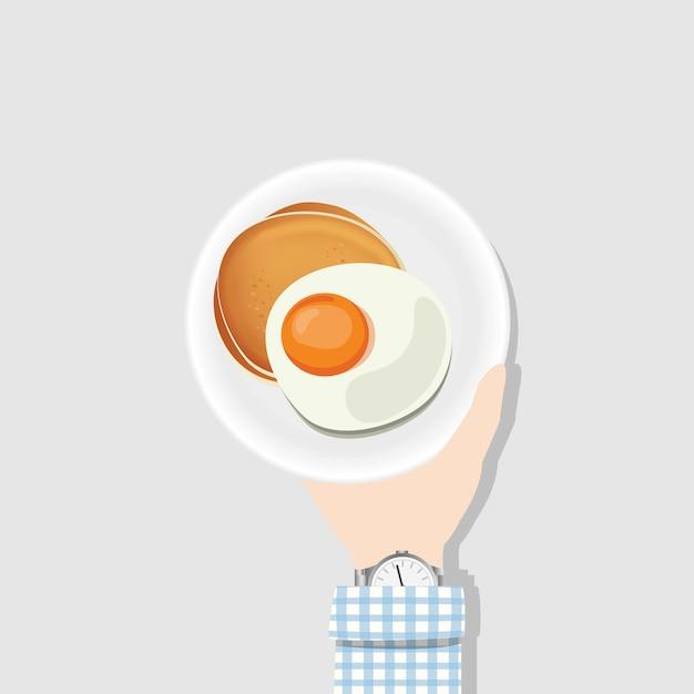 Gebakken eieren en pannenkoeken Gratis Vector