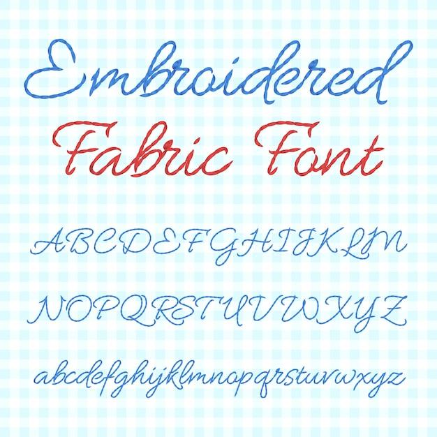 Geborduurd stoffenlettertype met kalligrafische letters. Premium Vector