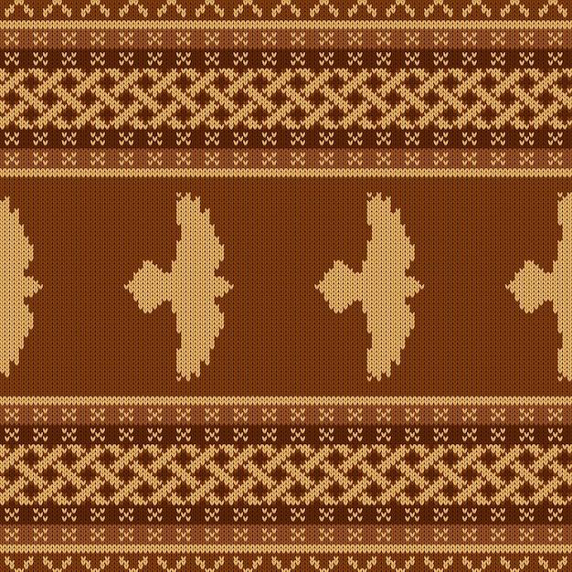 Gebreid naadloos keltisch nationaal ornament met raaf Premium Vector