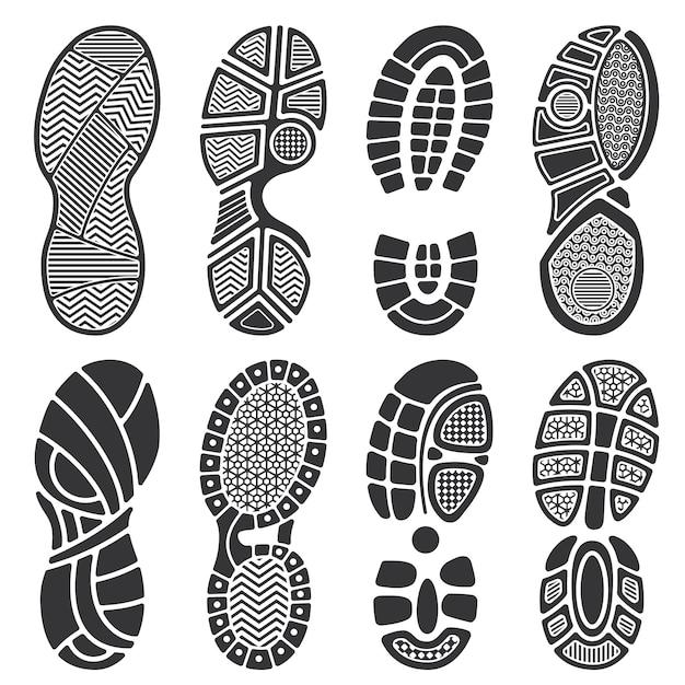 Geïsoleerde voetafdruk vectorsilhouetten. vuile schoenen en sneakers voetafdrukken Premium Vector