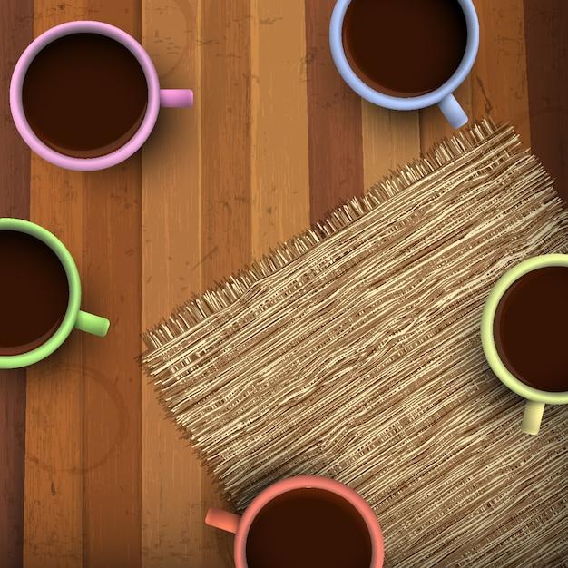 Gekleurde kop koffie op houten Premium Vector