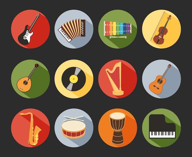 Gekleurde platte muzikale pictogrammen geïsoleerd op zwarte achtergrond Gratis Vector