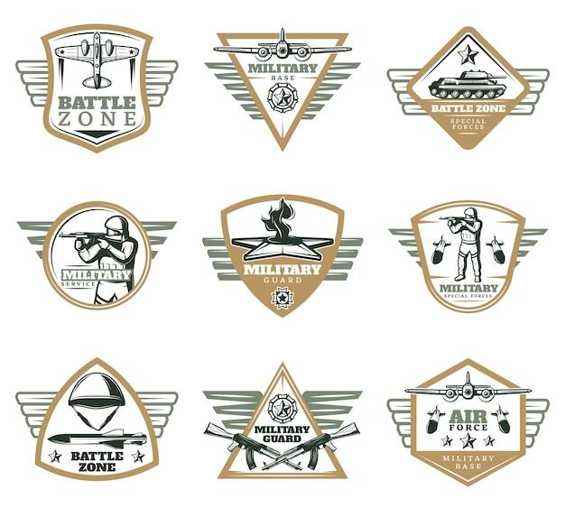 Gekleurde vintage militaire emblemen set Gratis Vector