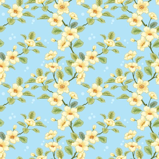 Gele bloemen op blauwe achtergrond voor textiel, stof, katoenweefsel, dekking, behang, Premium Vector