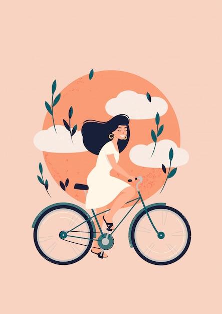 Gelukkig brunette vrouw rijdt op een fiets voor de zon met wolken Premium Vector