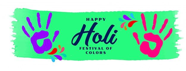 Gelukkig holi hand kleur print banner Gratis Vector