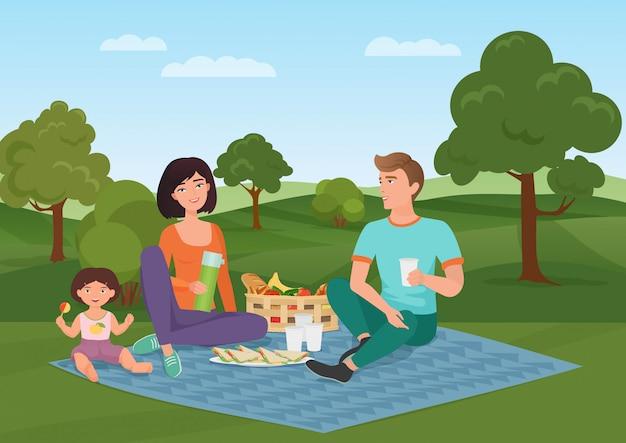 Gelukkig jong gezin met kind op een picknick. vader, moeder en dochter rusten in de natuur. Premium Vector