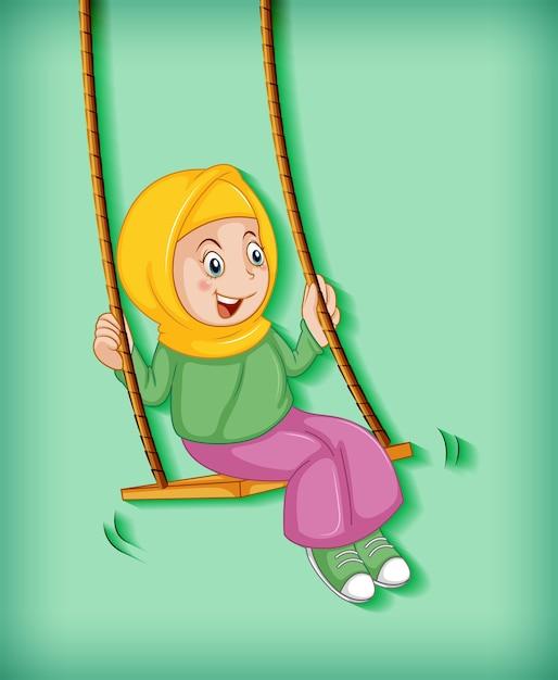 Gelukkig moslimmeisje zit op schommel Gratis Vector