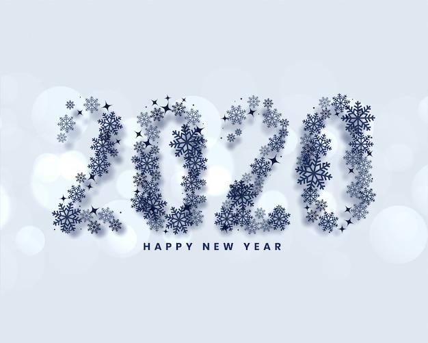 Gelukkig nieuw jaar 2020 geschreven in sneeuwvlokkenstijl Gratis Vector