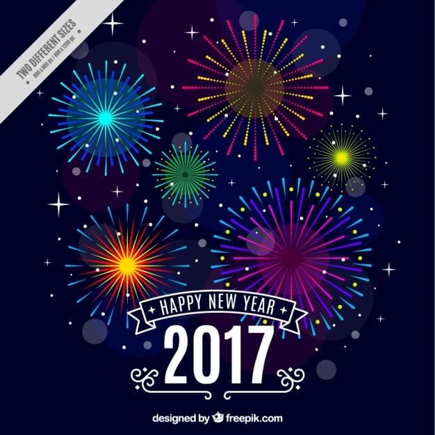 Gelukkig Nieuwjaar achtergrond met kleurrijke vuurwerk Gratis Vector