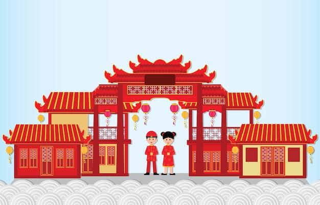 Gelukkig nieuwjaar in china town met chinees jongen en meisje. Premium Vector