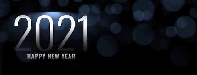 Gelukkig nieuwjaar op bokeh lichteffectachtergrond Gratis Vector