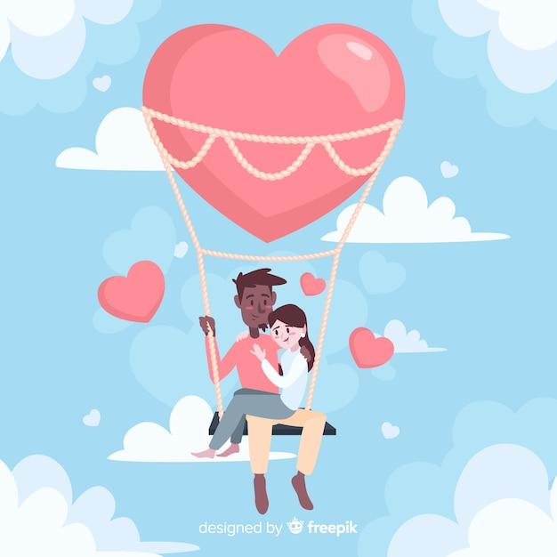 Gelukkig paar in een hete luchtballon Gratis Vector