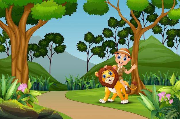 Gelukkige dierenverzorger met een leeuw in de jungle Premium Vector