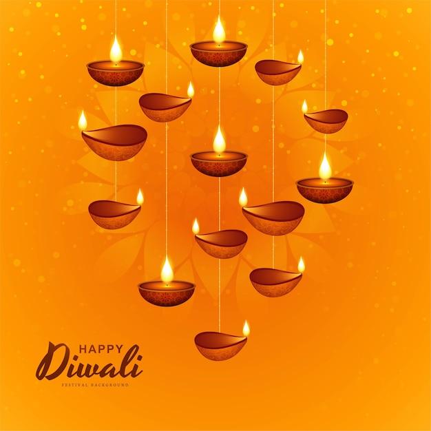 Gelukkige diwali decoratieve hangende olielamp viering achtergrond Gratis Vector