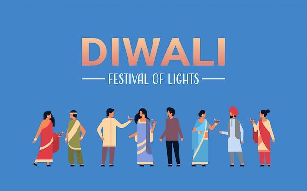 Gelukkige diwali indiase mensen groep dragen nationale traditionele kleding houden olie banner Premium Vector