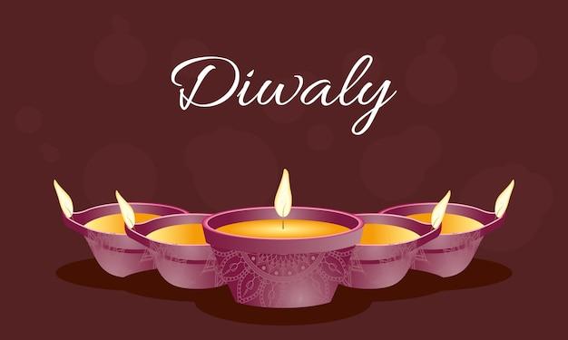 Gelukkige diwali-viering belettering met kaarsen Premium Vector