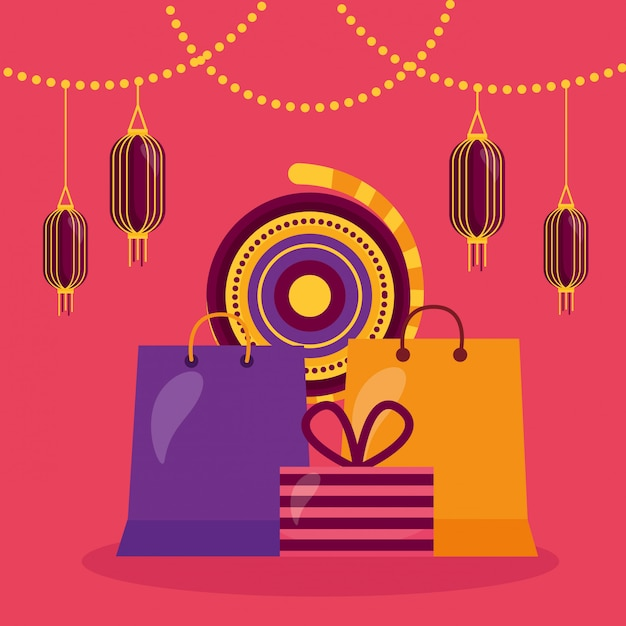 Gelukkige diwalikaart met het winkelen zakken en lampen het hangen Gratis Vector
