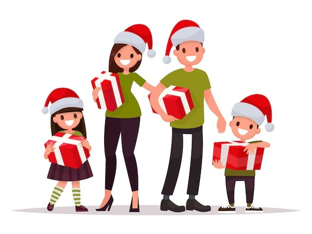 Gelukkige familie met kerstmis met geschenken. Premium Vector