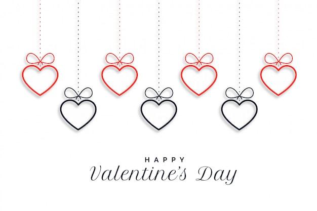 Gelukkige hangende de hartenachtergrond van de valentijnskaartendag Gratis Vector