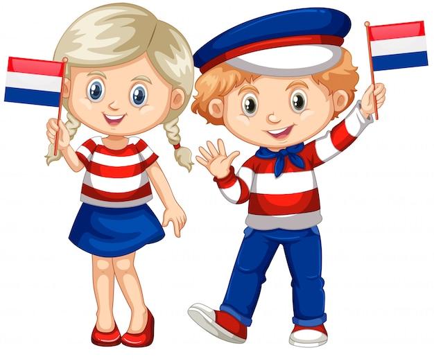 Gelukkige jongen en meisjesholdingsvlag van netherland Gratis Vector