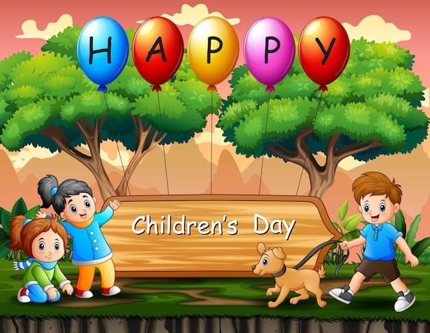 Gelukkige kinderen dag poster met kinderen spelen in het park Premium Vector
