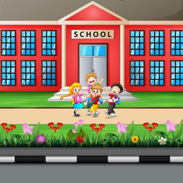 Gelukkige kinderen die naar school gaan Premium Vector