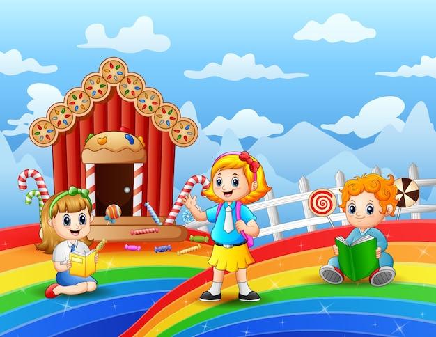 Gelukkige kinderen leren in een snoepland Premium Vector