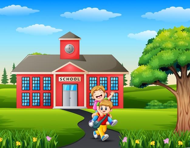 Gelukkige kleine kinderen die naar school gaan Premium Vector