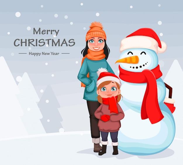 Gelukkige moeder en dochter die zich met sneeuwman bevinden Premium Vector