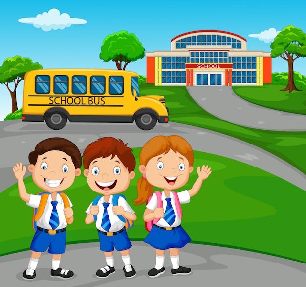 Gelukkige schoolkinderen voor de school Premium Vector
