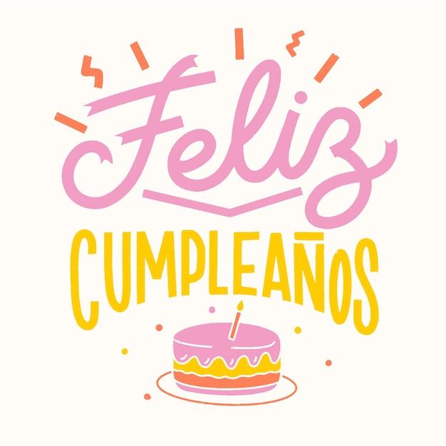 Gelukkige verjaardag belettering met cake Gratis Vector