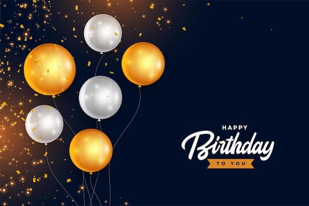 Gelukkige verjaardag gouden en zilveren ballonnen met confetti Gratis Vector