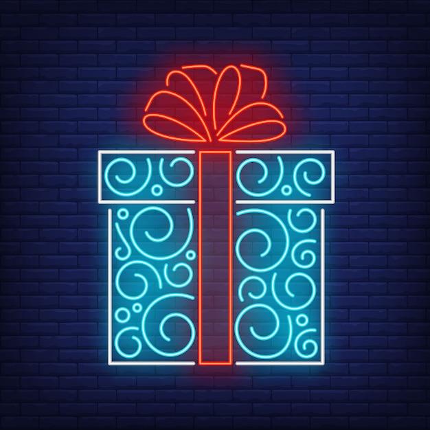 Geschenkdoos in neon stijl Gratis Vector