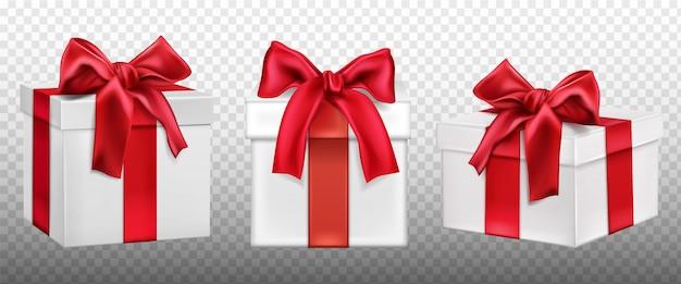 Geschenkdozen of geschenkdozen met rode strikset. Gratis Vector