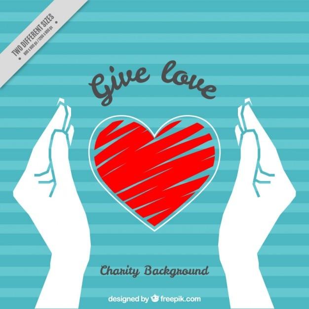 Gestreepte achtergrond met handen en met de hand geschilderd hart Gratis Vector